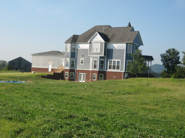120 Acres On Highway 61 - Side view of house
